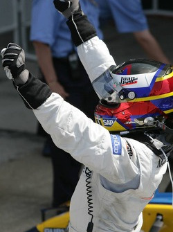 Race winner Juan Pablo Montoya celebrates