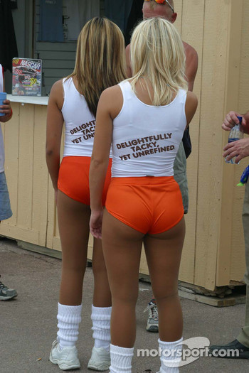 Trophy girls await the end of the race