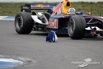 David Coulthard passes by a debris from the Sauber of Jacques Villeneuve