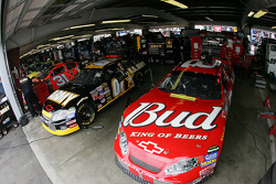 Bud Chevy and U.S. Army Chevy sit in garage