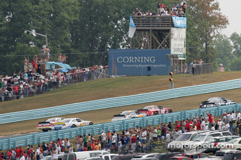 Fans and spotters watch race action at the Esses