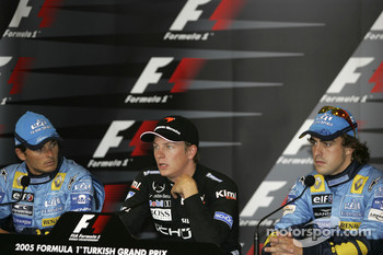 Press conference: pole winner Kimi Raikkonen with Giancarlo Fisichella and Fernando Alonso