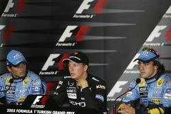 Press conference: pole winner Kimi Raikkonen with Giancarlo Fisichella and Fernando Alonso