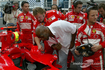 Mike Tyson has a look at the Ferrari