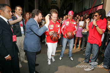 Vodafone race event in Milan: Rubens Barrichello and Michael Schumacher play basketball