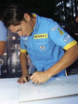 Giancarlo Fisichella autographs his hand print