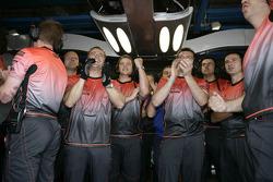 McLaren team members celebrate 1-2 fastest laps