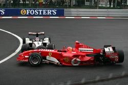 Michael Schumacher and Takuma Sato crash