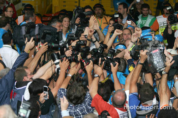2005 World Champion Fernando Alonso celebrates with photographers