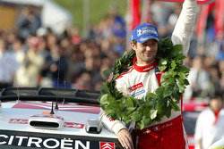 Podium: 2005 WRC champion Sébastien Loeb celebrates