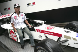 At home in Tokyo with Takuma Sato: Takuma Sato poses with a BAR-Honda