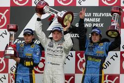 Podium: race winner Kimi Raikkonen with Giancarlo Fisichella and Fernando Alonso