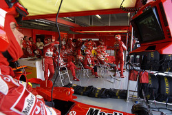 Ferrari team members wait for next pitstop
