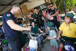 WSBK riders work on motorcycles at a local school in Australia