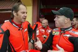 Gerhard Berger rides the Ducati MotoGP Desmosedici with Randy Mamola