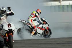 World champion Valentino Rossi celebrates