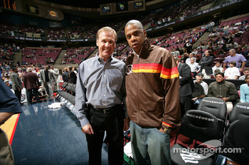 Rusty Wallace and Def Jam artist Jay-Z pose for a photograph prior to the start of the game between the New Jersey Nets and the Detroit Pistons at the Continental Airlines Arena in East Rutherford, New Jersey