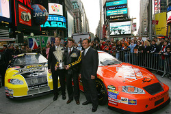 Joe Gibbs Racing president J.D. Gibbs, Tony Stewart and crew chief Greg Zipadelli celebrate in Times Square
