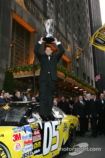 NASCAR Nextel Cup Awards Banquet at the Waldorf Astoria Hotel: Tony Stewart, the 2005 NASCAR Nextel Cup Series Champion, holds up his trophy
