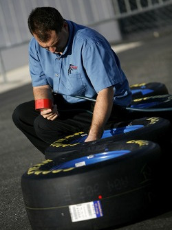 A crew member checks the tire pressure