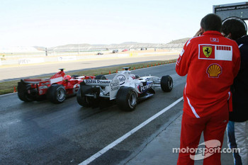 Michael Schumacher and Mark Webber on pitlane