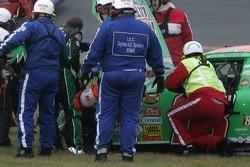 J.J. Yeley checks the damage on his car