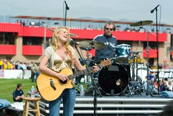 Recording artist Jewel performing with her band during pre-race activities