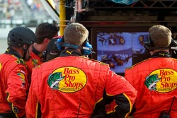 Team members for Martin Truex Jr., review a recording of their pit stop perfromance