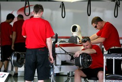 Super Aguri F1 team members at work