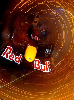 The Red Bull Racing RB2 flies over the stage during the presentation