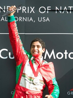Race winner Salvador Duran of Team Mexico raises his trophy