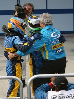 Race winner Giancarlo Fisichella celebrates with Fernando Alonso and Flavio Briatore