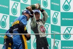Podium: champagne for Giancarlo Fisichella, Fernando Alonso and Jenson Button