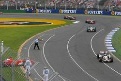 Jenson Button leads the field under caution