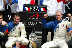 Nicolas Lapierre (FRA) A1 Team France and Alexandre Premat (FRA) A1 Team France celebrate with their team after claiming the title at Laguna Seca