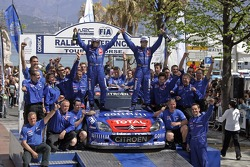 Winners Sébastien Loeb and Daniel Elena celebrate with their team