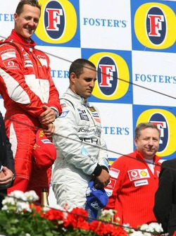 Podium: race winner Michael Schumacher with Juan Pablo Montoya
