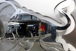 Red Bull Racing trucks and the tree house mirrored in the the Red Bull logo