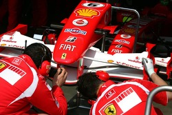 Ferrari mechanic takes a photo of the front wing