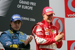 Podium: race winner Michael Schumacher with Fernando Alonso