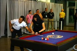 Helio Castroneves receives pool tips from billiards star Jeanette Lee