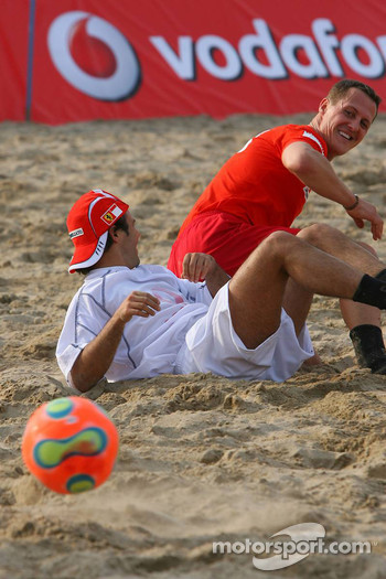 Vodafone Ferrari Beach Soccer Challenge: Michael Schumacher pulls Felipe Massa to the floor