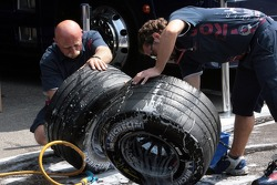 Scuderia Toro Rosso members clean Michelin tires