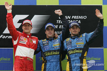 Podium: race winner Fernando Alonso celebrates with Michael Schumacher and Giancarlo Fisichella