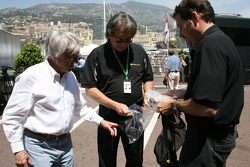 Kangaroo TV gets presented to  Bernie Ecclestone by Marc Arseneau on the right