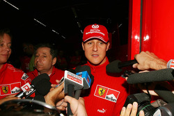 Michael Schumacher gives a press announcement at 9.42pm