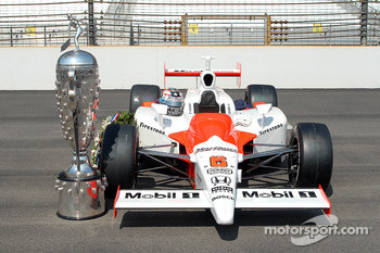 The 2006 Indy 500 winning car with the Borg Warner trophy