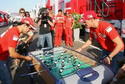 Michael Schumacher and Felipe Massa play table football