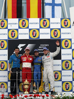Podium: Race winner Fernando Alonso, second place, Michael Schumacher, third place, Kimi Raikkonen