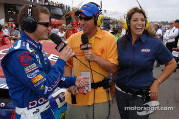 Kasey Kahne talks with actor Adam Sandler